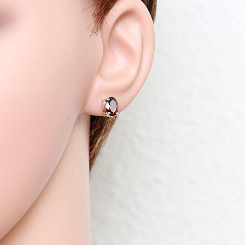 Boucles d oreilles Or 375 Grenat ref 44014 2    Puces d'oreilles Or blanc 375 Grenat Ovale 8x6mm, Puces d'oreilles en Or blanc 375 (9 carats), Grenats ovales de 8x6mm (1,2 carat/pièce), Système de fermeture : poussettes belges, Métal : Or Blanc 375, Poids Métal : 1gr., bijou en Or Blanc 375 pour Femme Livré sous écrin avec certificat d'authenticité Or 375