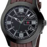 Gucci Hommes YA126203 Gucci Timeless Rights Watch 5 Bijoutier Boutique Stainless steel case with a brown rubber bracelet. Fixed bezel. Black dial with luminous tipped hands and stick hour markers. Arabic numerals mark the 3, 6, 9, and 12 positions. Minute markers around the outer rim. Luminiscent hands and markers. Date displays at the 4 o'clock position. Electronic quartz movement. Scratch resistant sapphire crystal. Case diameter: 45 mm. Case thickness: 13 mm. Tang clasp. Water resistant at 30 meters/ 100 feet. Functions: hours, minutes, seconds, date. Gucci Timeless Mens Watch YA126203.