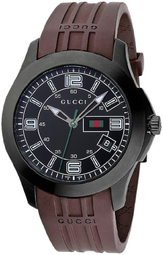 Gucci Hommes YA126203 Gucci Timeless Rights Watch 2 Bijoutier Boutique Stainless steel case with a brown rubber bracelet. Fixed bezel. Black dial with luminous tipped hands and stick hour markers. Arabic numerals mark the 3, 6, 9, and 12 positions. Minute markers around the outer rim. Luminiscent hands and markers. Date displays at the 4 o'clock position. Electronic quartz movement. Scratch resistant sapphire crystal. Case diameter: 45 mm. Case thickness: 13 mm. Tang clasp. Water resistant at 30 meters/ 100 feet. Functions: hours, minutes, seconds, date. Gucci Timeless Mens Watch YA126203.