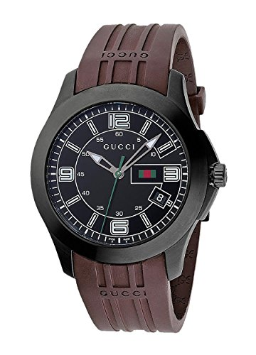 Gucci Hommes YA126203 Gucci Timeless Rights Watch 1 Bijoutier Boutique Stainless steel case with a brown rubber bracelet. Fixed bezel. Black dial with luminous tipped hands and stick hour markers. Arabic numerals mark the 3, 6, 9, and 12 positions. Minute markers around the outer rim. Luminiscent hands and markers. Date displays at the 4 o'clock position. Electronic quartz movement. Scratch resistant sapphire crystal. Case diameter: 45 mm. Case thickness: 13 mm. Tang clasp. Water resistant at 30 meters/ 100 feet. Functions: hours, minutes, seconds, date. Gucci Timeless Mens Watch YA126203.